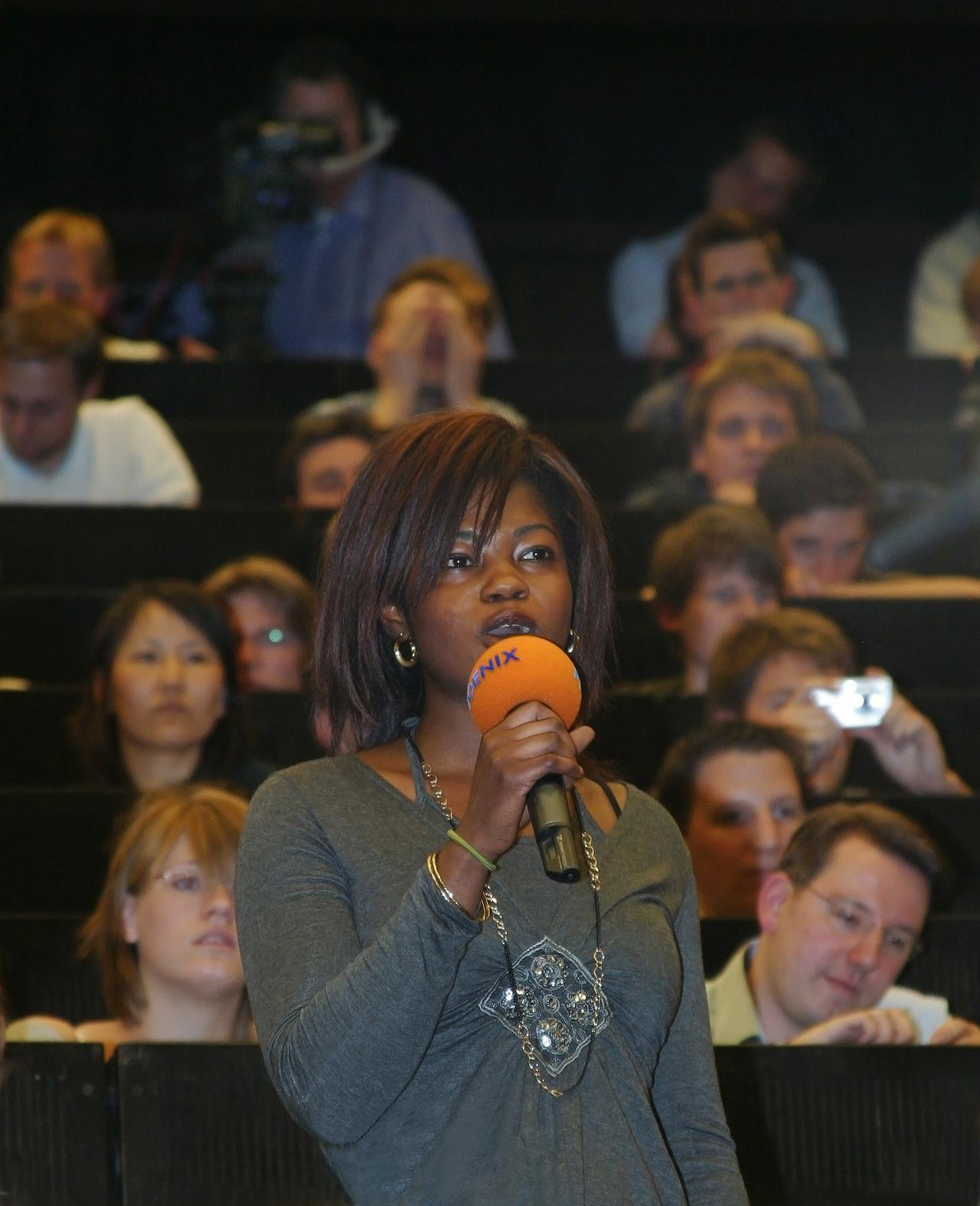 Moderator in front of an audience