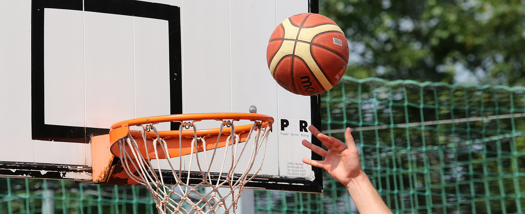 A basketball going in a net