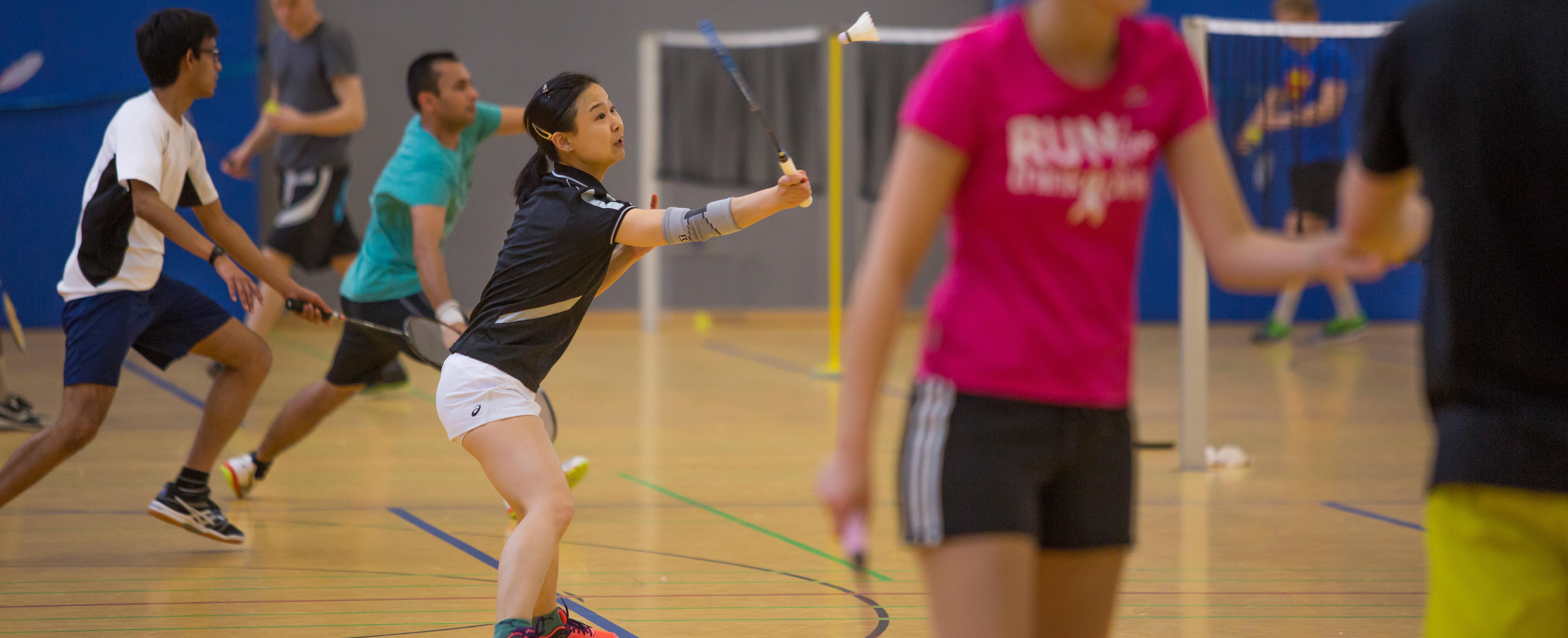 Badminton player at the net