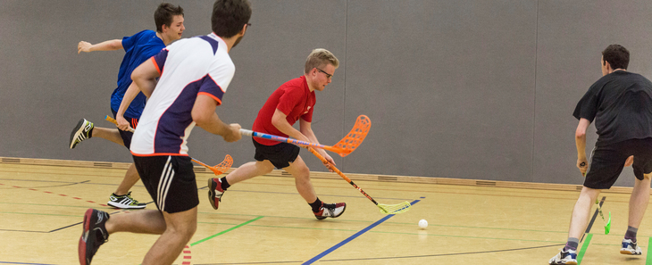 Floorball player dribbling