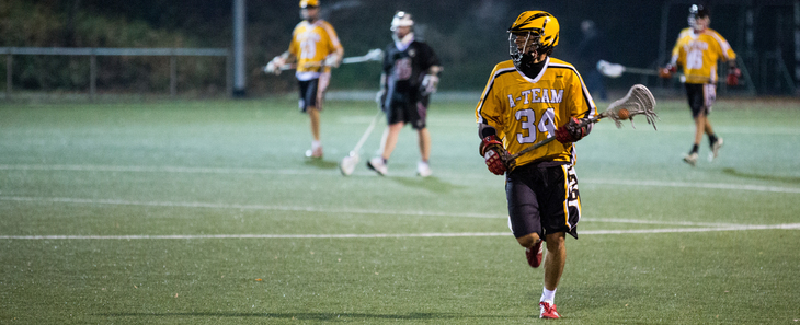 Lacrosse player running on the field
