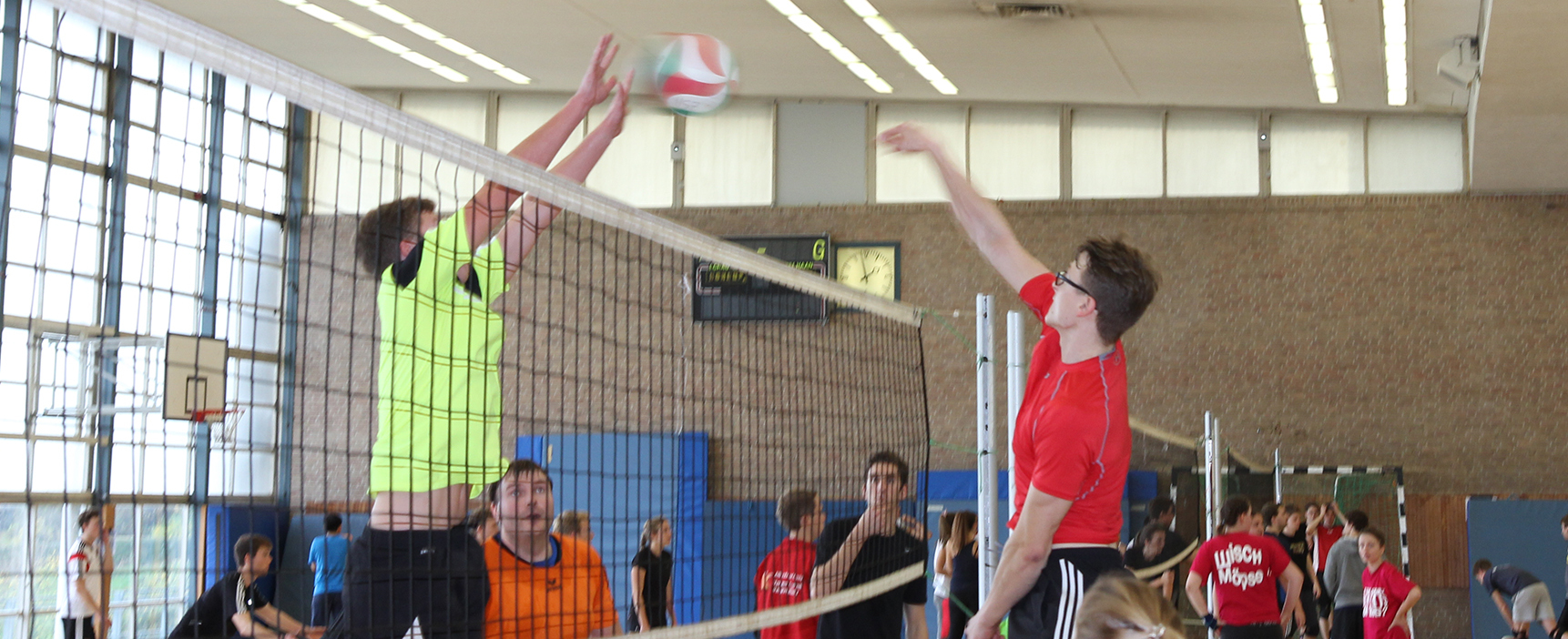 A volleyball player blocking the ball