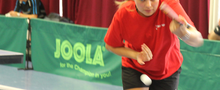 A female gamer playing table tennis