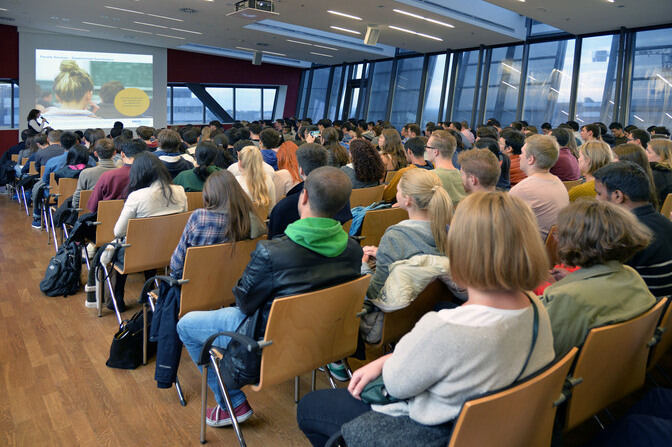 Room with visitors at the Welcome Day